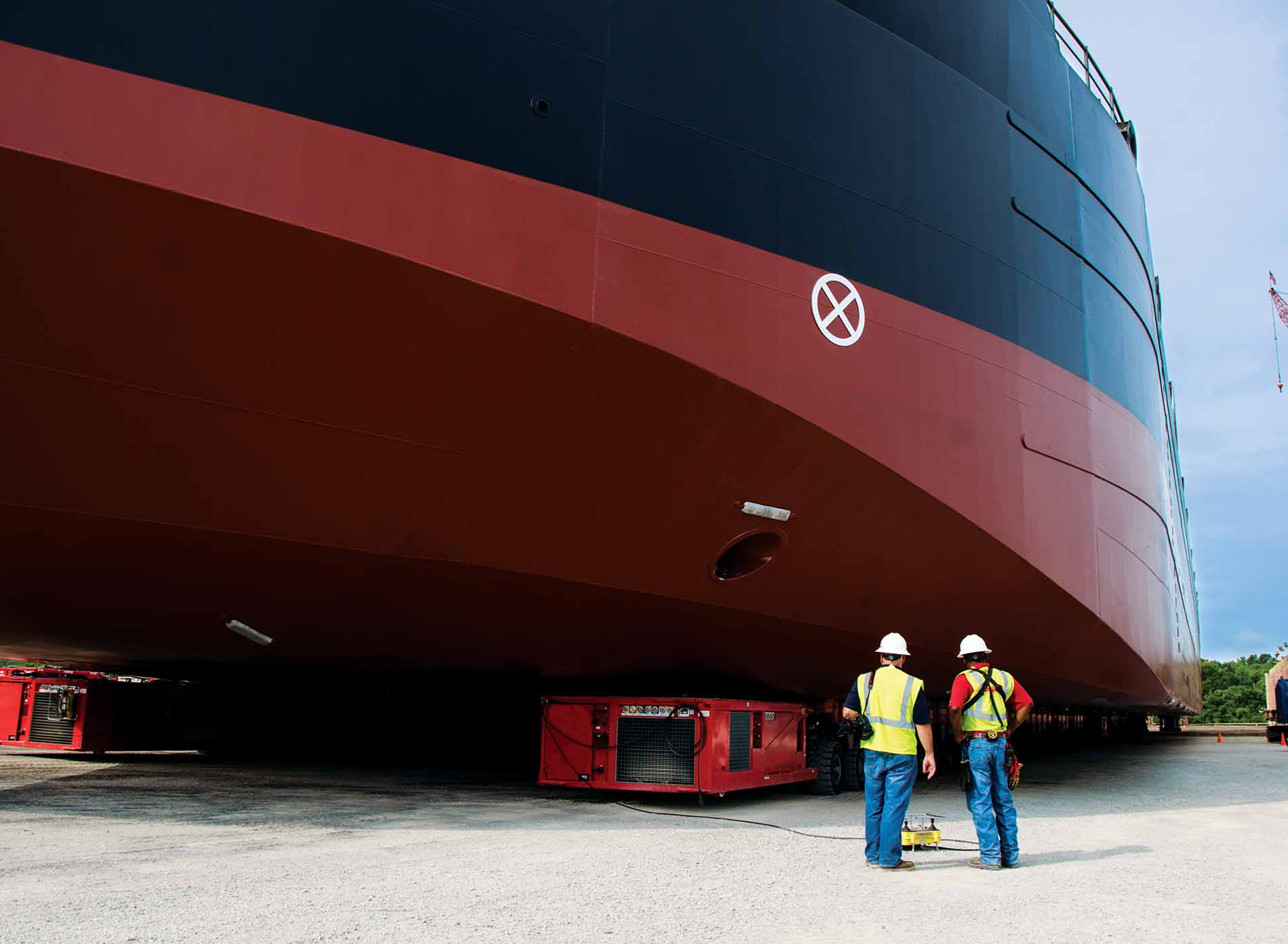 Two men standing in front of a ship