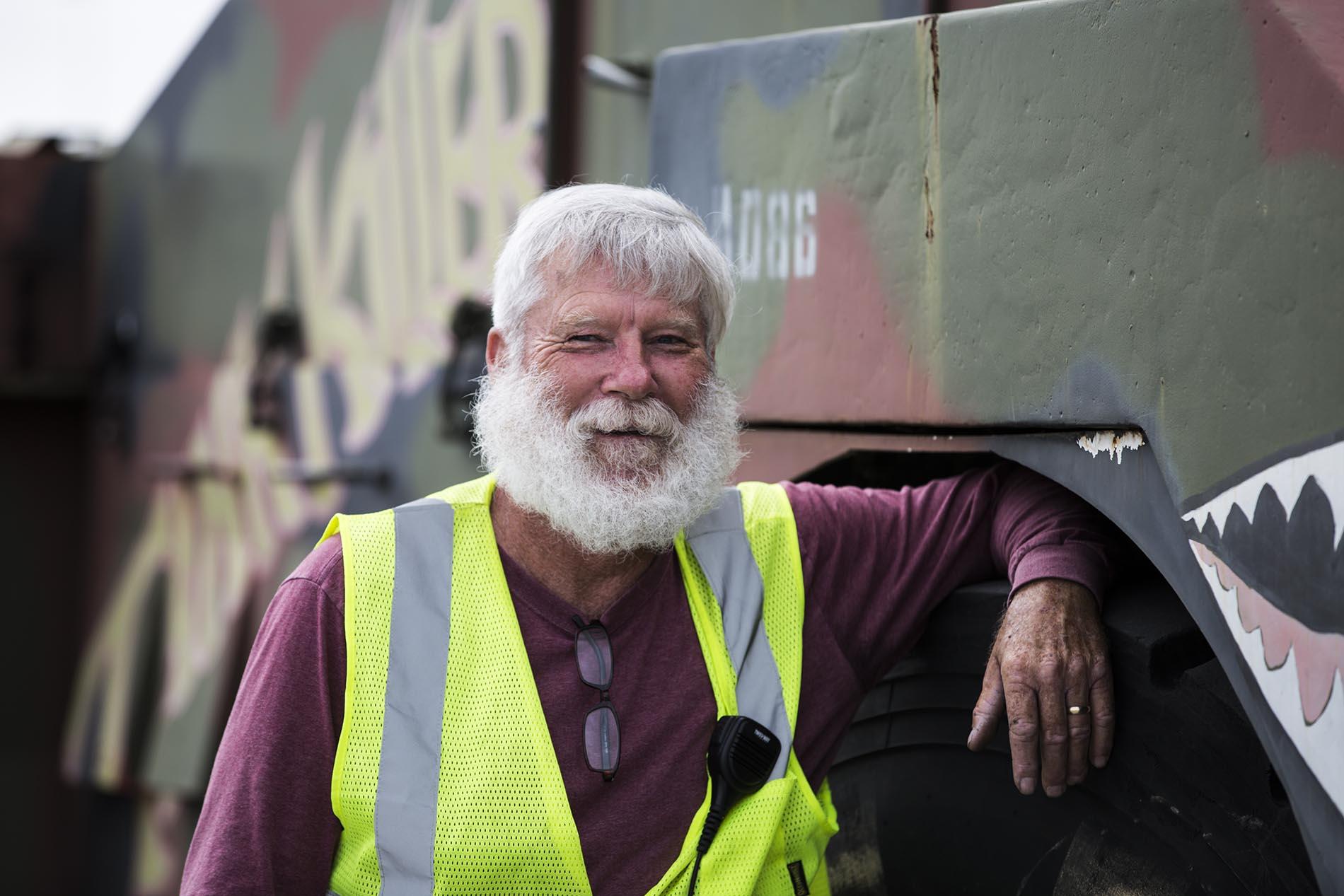 Bearded man green vest