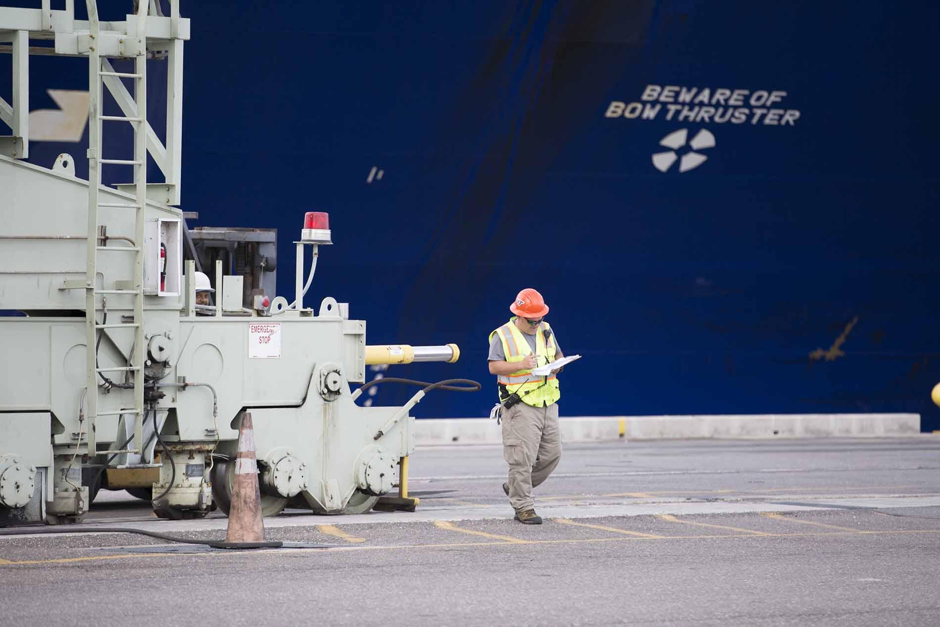 Worker walking in shipyard