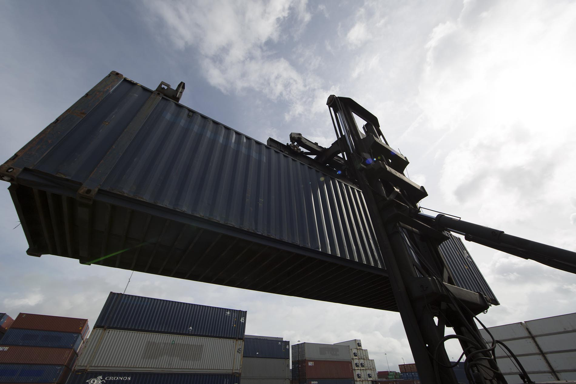 Containers on spreader lift