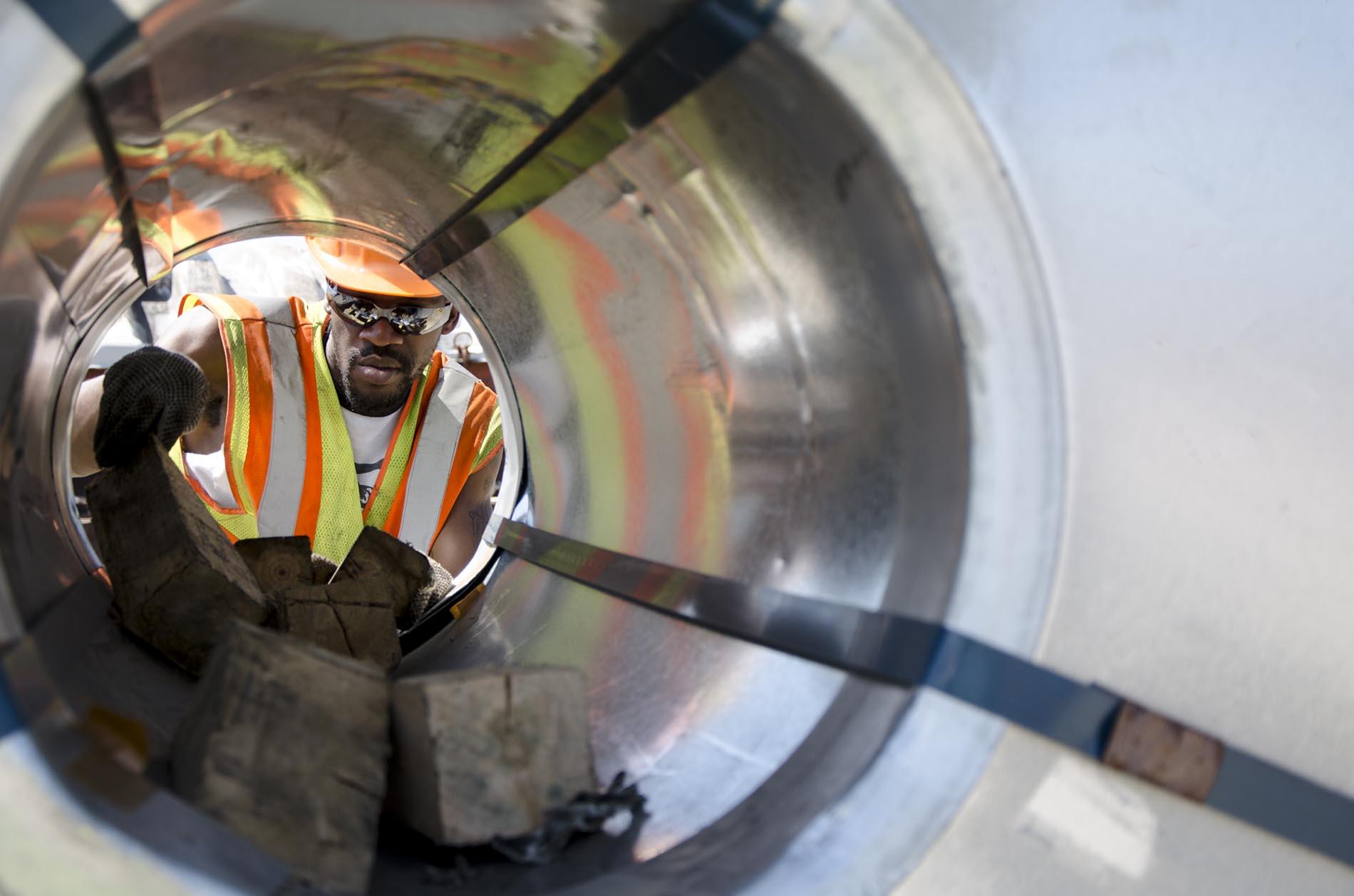 Man chocking inside steel coils