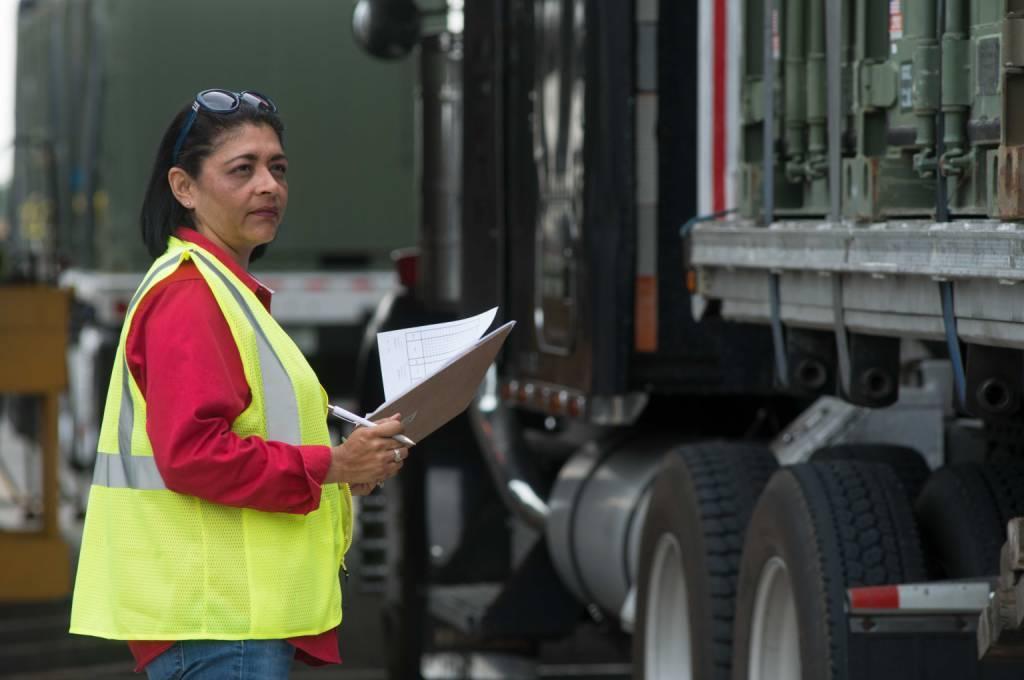 female worker holding clip board
