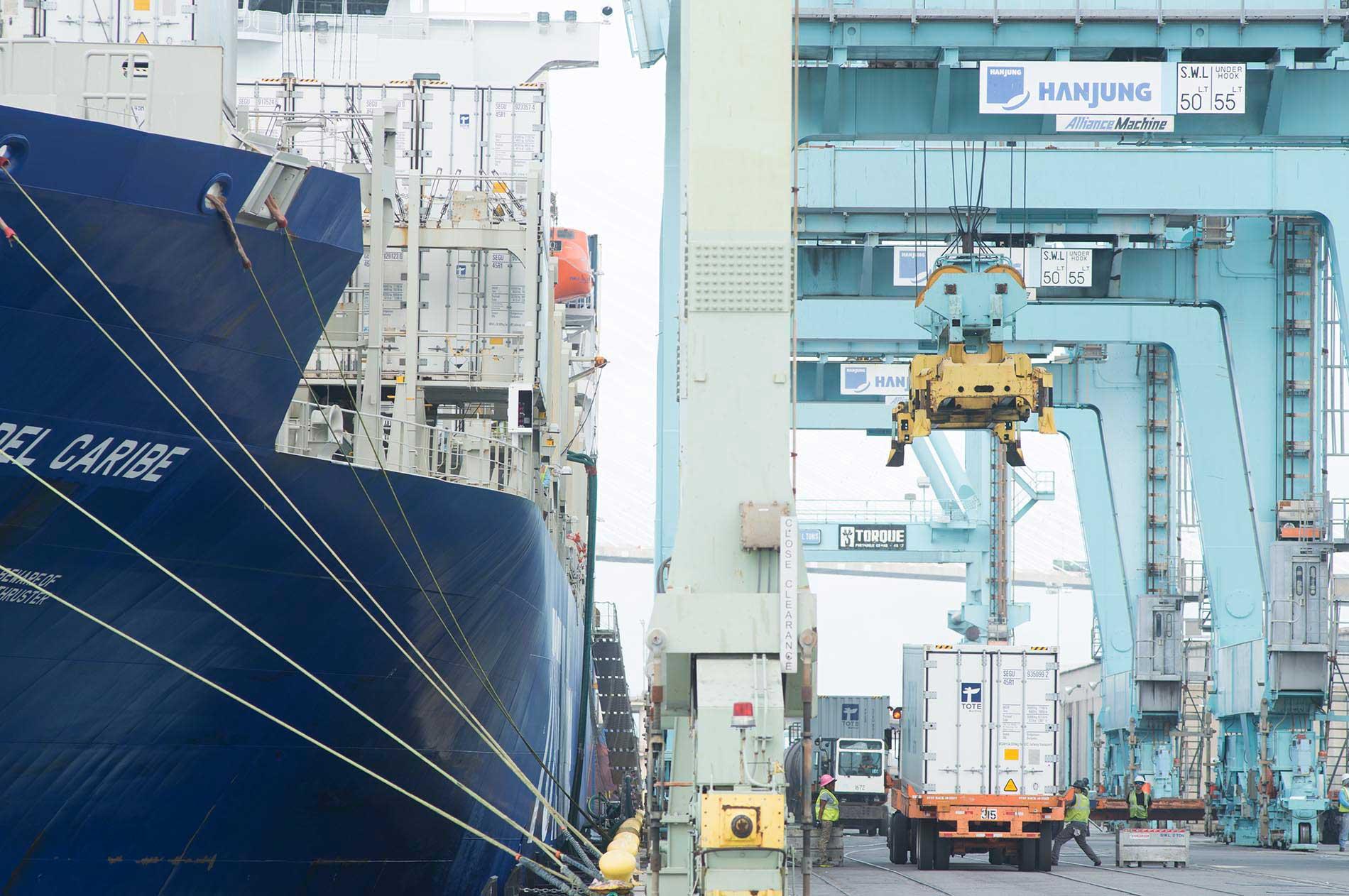 Ship at dock large cranes close up