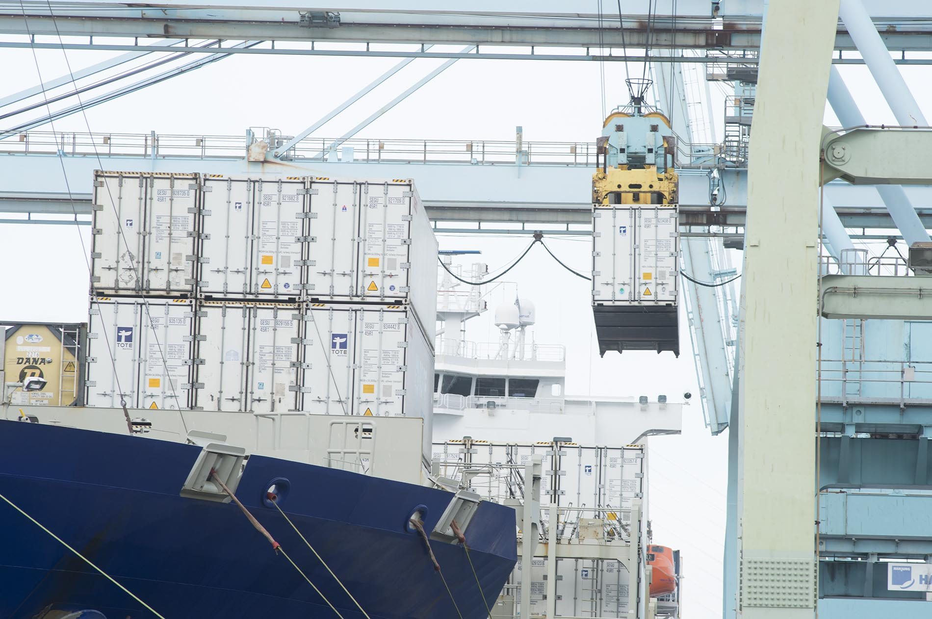 Containers loaded onto ship