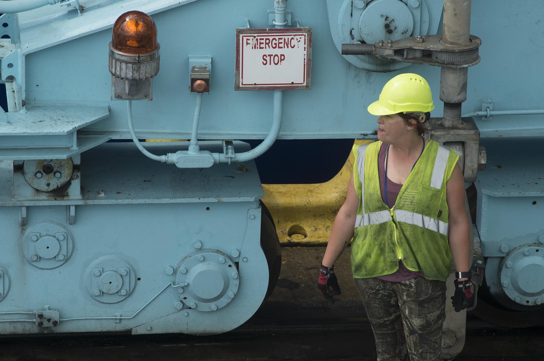 Female green hard hat large equipment