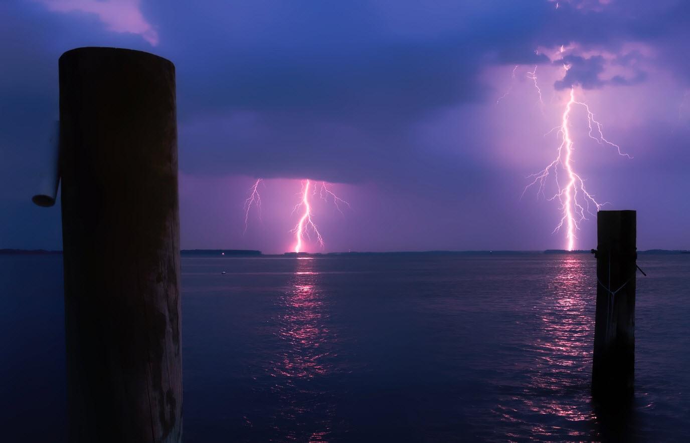 Lightning strikes over water