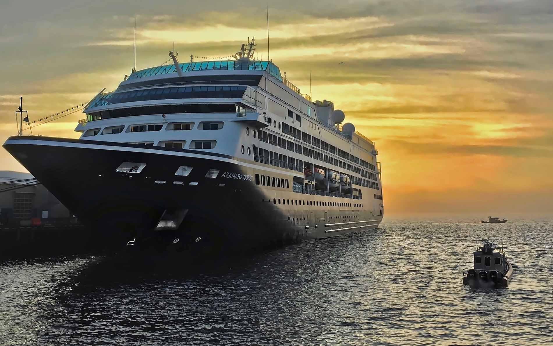 Cruise ship and tug boats at sunset