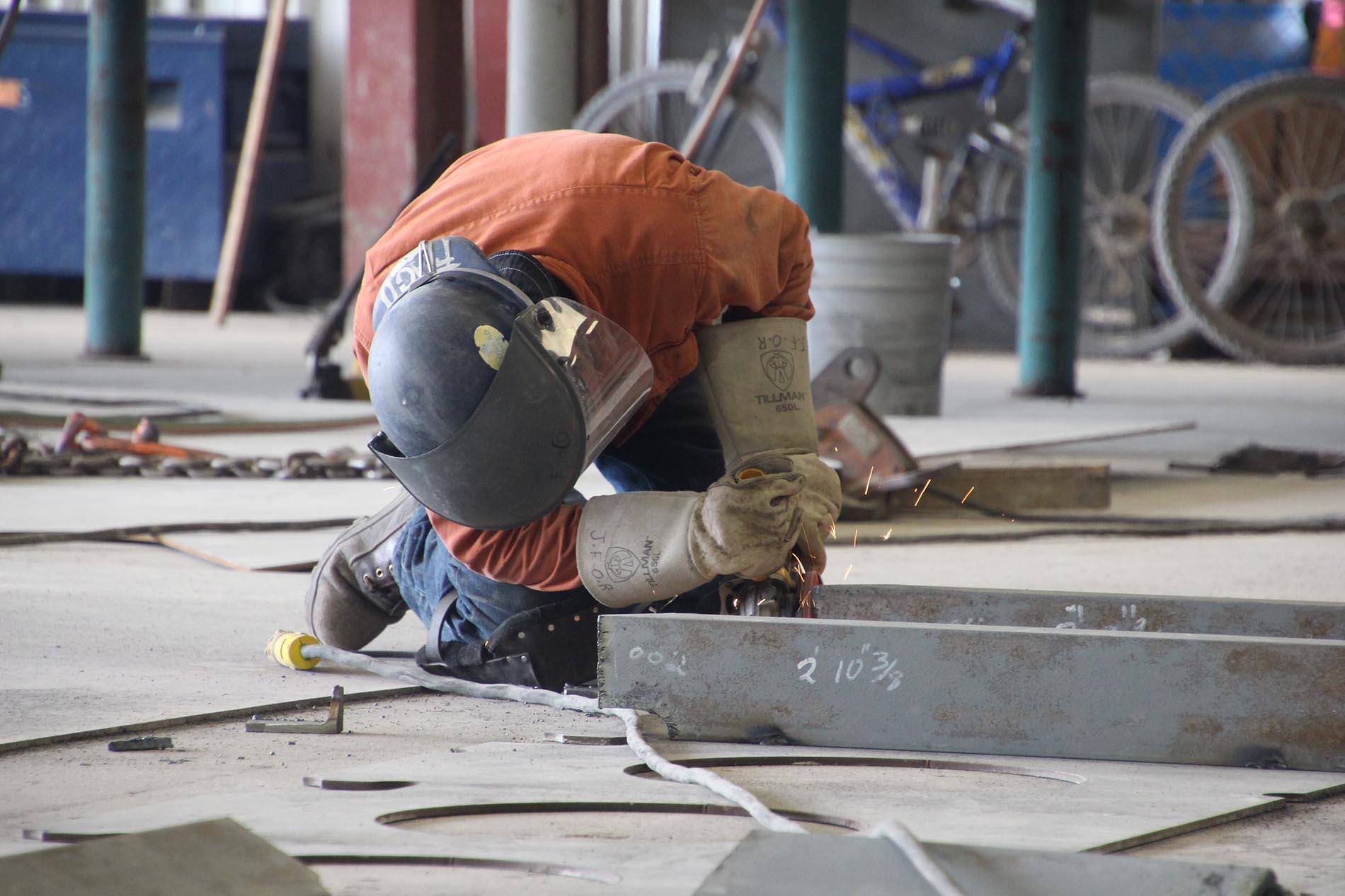 Worker kneeling