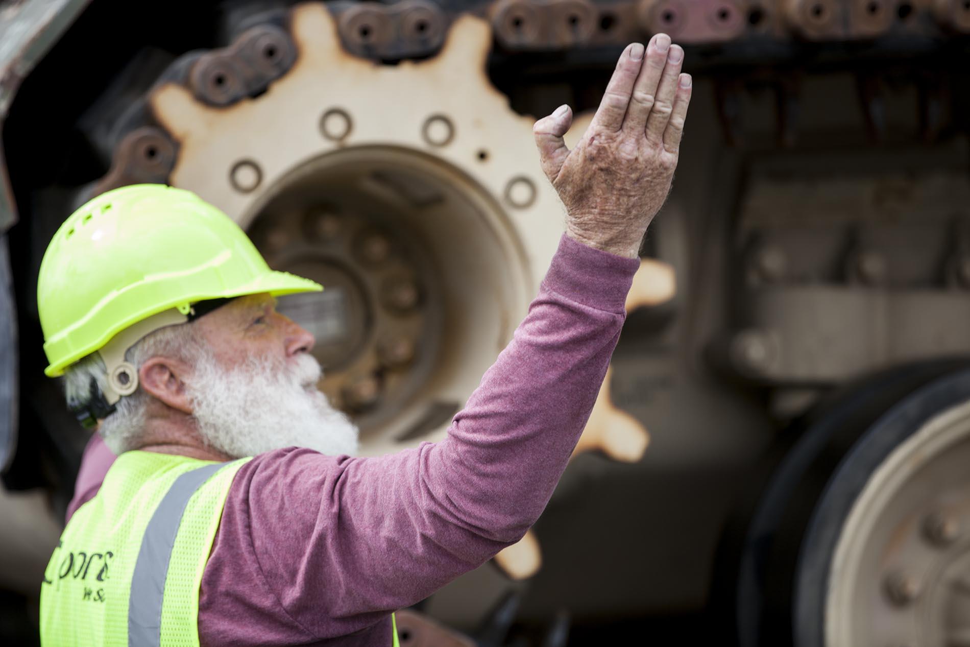 Bearded man directing cargo