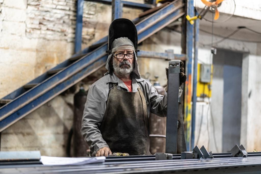 Older worker welding