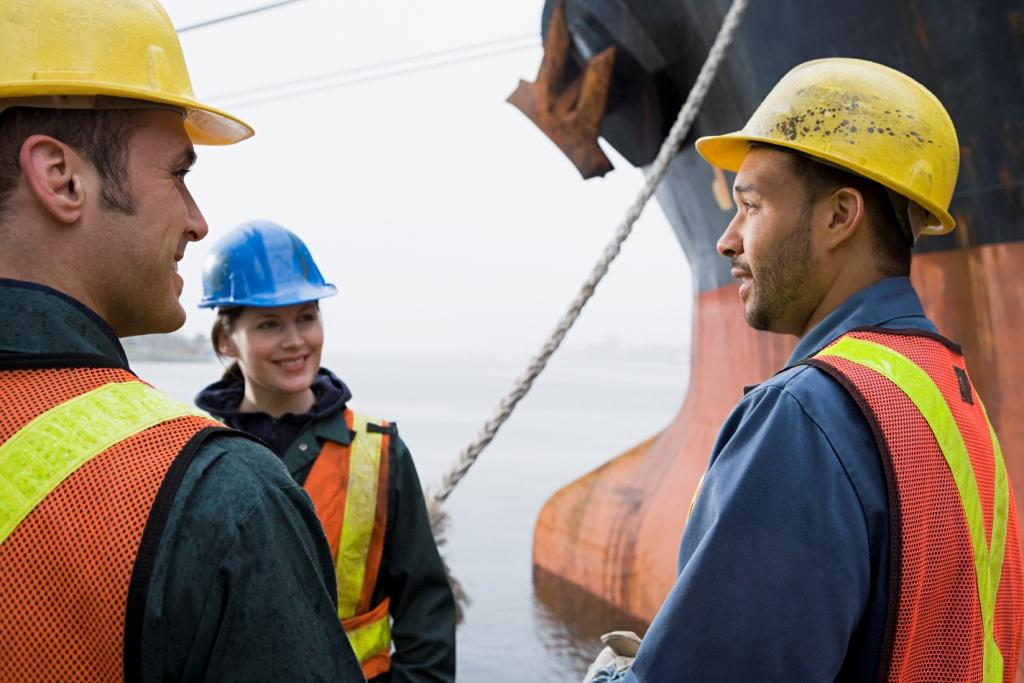 Workers talking in front of ship