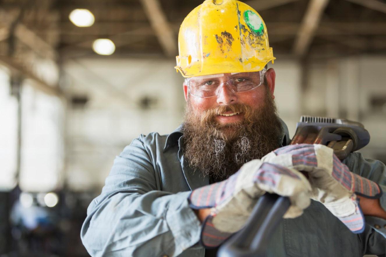 Man in hard hat wearing PPE