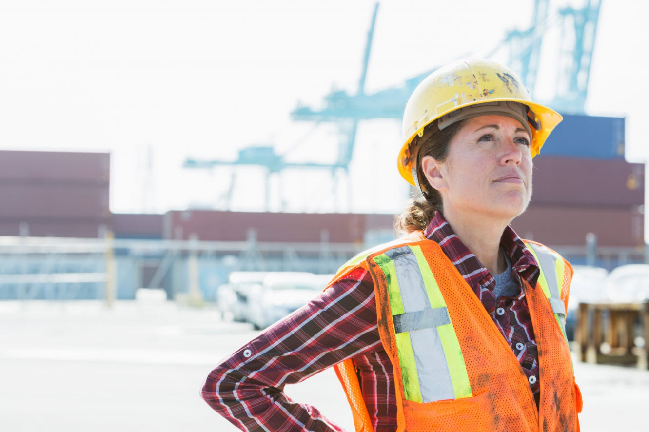 Woman wearing hardhat and PPE